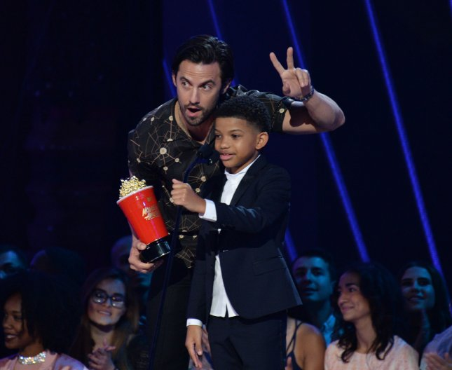 Actors Milo Ventimiglia (L) and Lonnie Chavis accept the Tearjerker award for This Is Us' onstage during the MTV Movie & TV Awards on May 7. The cast of This Is Us roamed the streets of New York with Billy Eichner for a segment on his TruTV show Billy on the Street. Photo by Jim Ruymen/UPI