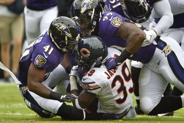 Chicago Bears safety Eddie Jackson (39) is smothered by Baltimore Ravens   Anthony Levine (41) and Matt Judon (99) during the first half of an NFL  game at ... dd68798bf