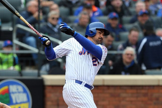 New York Mets first baseman Adrian Gonzalez hits an RBI double against the St. Louis Cardinals during the fifth inning on Opening Day on March 29 at Citi Field in New York City. Photo by Rich Schultz/UPI