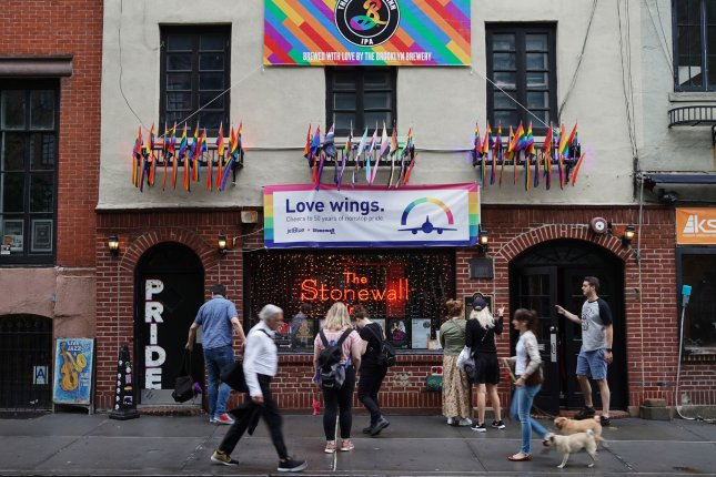 People stop to take pictures of the Stonewall Inn during LGBT Pride Month on June 19. On June 28, 1969, the clientele of the Stonewall Inn rioted after it was raided by police. The event is considered the start of the gay liberation movement. Photo by John Angelillo/UPI