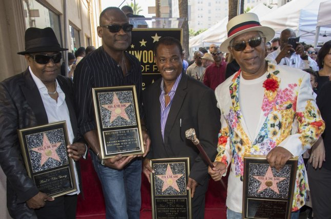 Left to right, Ronald Khalis Bell, George Brown, Robert Kool Brown and Dennis Thomas pose for photographers at a ceremony where Kool & The Gang received the 2,560th star on the Hollywood Walk of Fame in 2015. Thomas died Saturday at the age of 70.