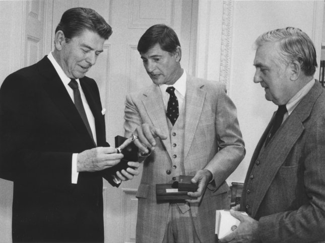 President Reagan meets with former baseball player Carl Yastrzemski (C) and Rep. Silvio Conte (R-MA), in the Oval office at the White House. Yastrzemski presented the president with a personal commemorative ring about his baseball career. (UPI Photo/Don Rypka/FILES)