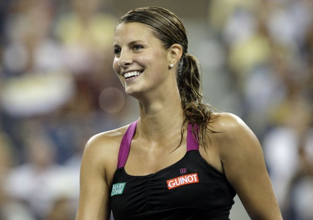 Mandy Minella, shown during a 2010 match, had an upset win Friday in advancing to the semifinals of the Gastein Ladies tennis tournament in Austria. . UPI/John Angelillo