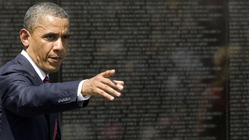 President Barack Obama at the Vietnam Veterans Memorial Wall in Washington DC, on May 28, 2012. UPI/Kristoffer Tripplaar/Pool