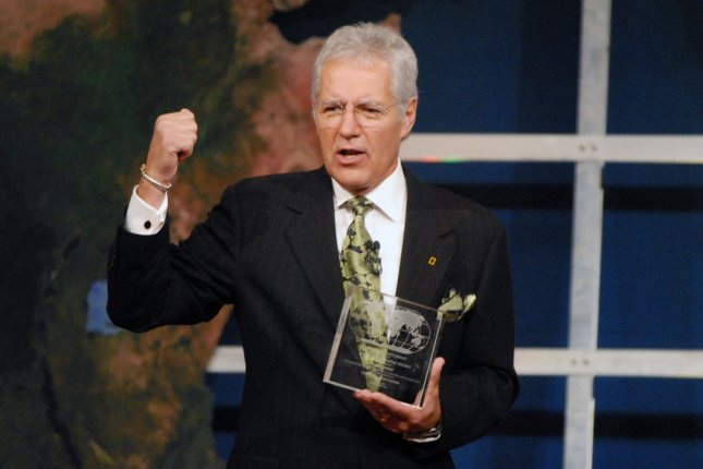 Host Alex Trebek reacts after he was recognized for his 20 years of hosting the National Geographic Bee at the 20th annual Bee in Washington on May 21, 2008. (UPI Photo/Alexis C. Glenn)