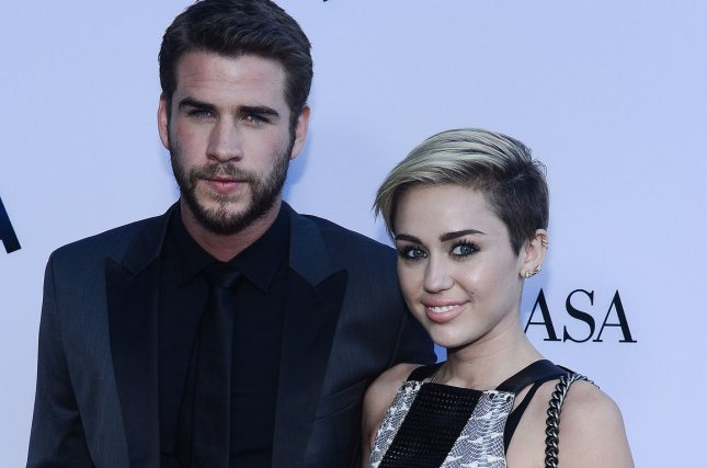 Cast member and star Liam Hemsworth (L) and Miley Cyrus attend the premiere of Paranoia on August 8, 2013. Hemsworth has shared a throwback photo of the couple on social media. File Photo by Jim Ruymen/UPI