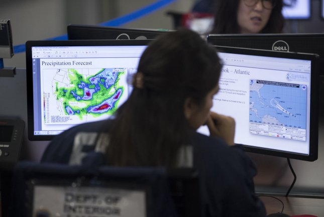 Employees work at the command center of the Federal Emergency Management Agency on August 4. The Department of Homeland Security on Wednesday ordered all federal agencies to stop using Kaspersky Labs cybersecurity products within 90 days. File Photo by Michael Reynolds/UPI