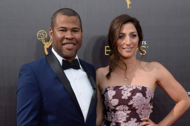 Jordan Peele, pictured here with wife Chelsea Peretti, is reportedly attached to a reboot of The Twilight Zone for CBS All Access. File Photo by Jim Ruymen/UPI
