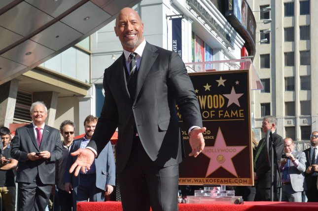 Actor Dwayne Johnson, aka The Rock, is working on a new physical competition series for NBC. File Photo by Jim Ruymen/UPI