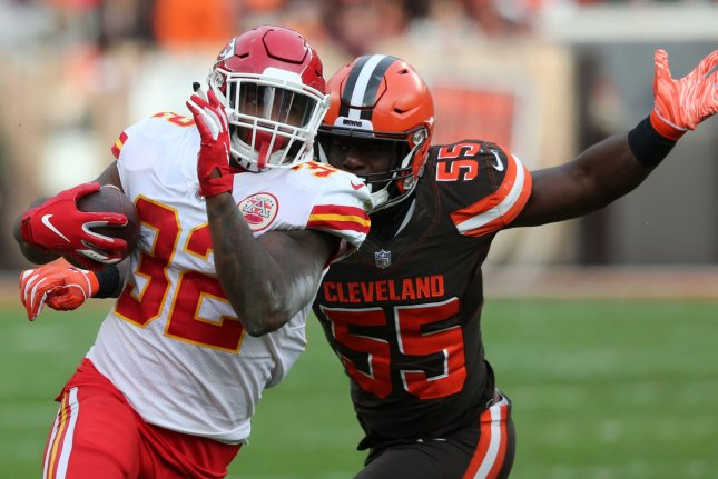 Kansas City Chiefs running back Spencer Ware tries to elude Cleveland Browns defender Genard Avery during their game at First Energy Stadium on November 4, 2018. Photo by Aaron Josefczyk/UPI