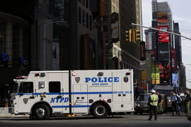 A NYPD bomb squad truck is seen in Times Square in 2016 as officers investigate reports of a suspicious package. File Photo by John Angelillo/UPI