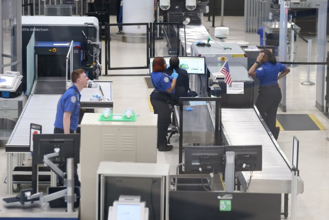 TSA agents wait for passengers at St. Louis-Lambert International Airport on March 28 soon after the pandemic disrupted air travel. File Photo by Bill Greenblatt/UPI