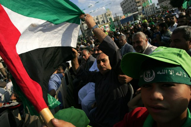 Palestinian Hamas supporters celebrate the recent release of hundreds of Palestinians by Israel in exchange for soldier Gilad Shalit, in Nusairat refugee camp in the central Gaza Strip, on October 28, 2011. UPI/Ismael Mohamad
