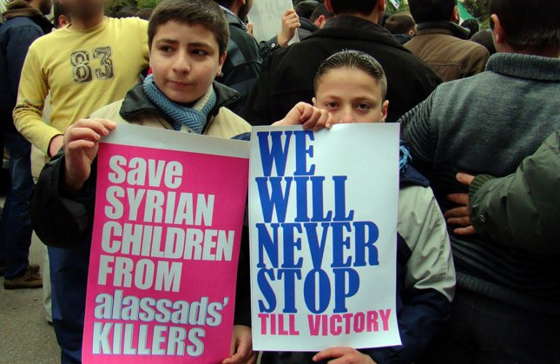 Demonstrators protest against Syria's President Bashar al-Assad after Friday prayers in Al-qsoor near Homs, Syria, March 16, 2012. UPI