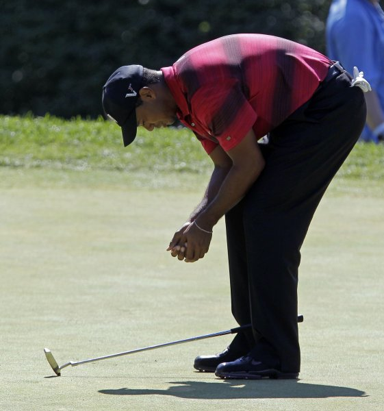 Tiger Woods reacts after missing a putt for birdie on the second hole in the final round of The Barclays at Ridgewood Country Club in New Jersey on August 29, 2010. UPI/John Angelillo