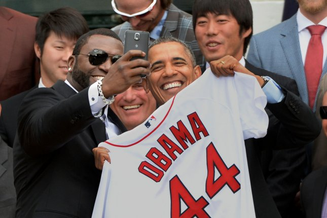 Boston Red Sox baseball player David Ortiz takes a selfie of himself and President Barack Obama after he gave the president a Boston Red Sox shirt during a ceremony in the South Lawn of the White House in Washington, DC on April 1, 2014. The president honored the Red Sox for winning Major League Baseball's World Series in 2013. UPI/Pat Benic
