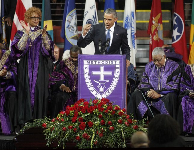 U.S.President Barack Obama speaks at the funeral of South Carolina State Senator and Rev, Clementa Pinckney at T.D. Arena in Charleston, South Carolina June, 26, 2015. Pinckney and eight other members were murdered at Emanuel A.M.E. church last week. Photo by Tami Chappell/UPI