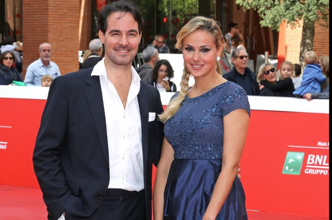 Vittorio Palazzi (L) and Isabelle Adriani arrive on the red carpet before the screening of the film Belle et Sebastien, l'aventure continue at the 10th annual Rome International Film Festival in Rome on October 17, 2015. UPI/David Silpa