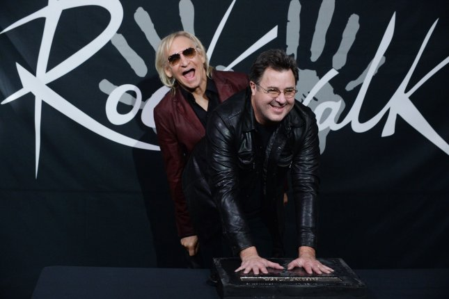 Country singer Vince Gill places his hands in wet cement as he is joined by musician Joe Walsh during a ceremony inducting him into Hollywood's RockWalk in Los Angeles on February 4, 2016. Photo by Jim Ruymen/UPI