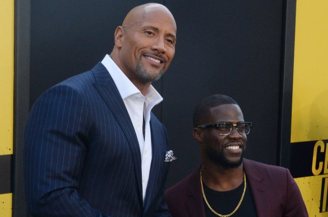 Dwayne Johnson (L) and Kevin Hart attending the premiere of Central Intelligence on June 10, 2016. Johnson slammed his Fast 8 co-stars on social media noting how some are unprofessional as compared to his female co-stars. File Photo by Jim Ruymen/UPI