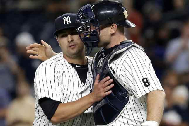 New York Yankees pitcher Nick Goody and Brian McCann celebrate after the game against the Baltimore Orioles at Yankee Stadium in New York City on July 19, 2016. The Yankees defeated the Orioles 7-1 and win the first 2 games of the 4 game series. Photo by John Angelillo/UPI