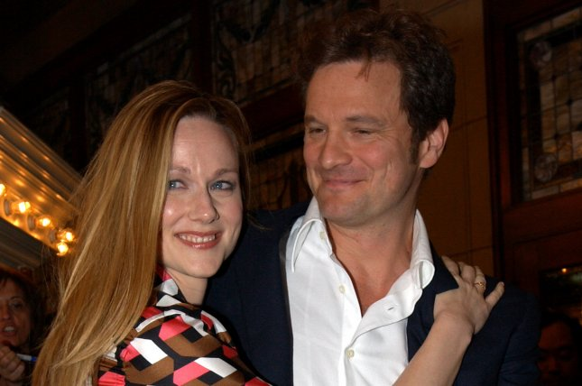 Actors Colin Firth and Laura Linney pose for photographers on the red carpet at the Toronto International Film Festival premiere of Love Actually on September 7, 2003. A short sequel to the beloved romantic comedy will air during next month's Red Nose Day telethon on the BBC. File Photo by Christine Chew/UPI