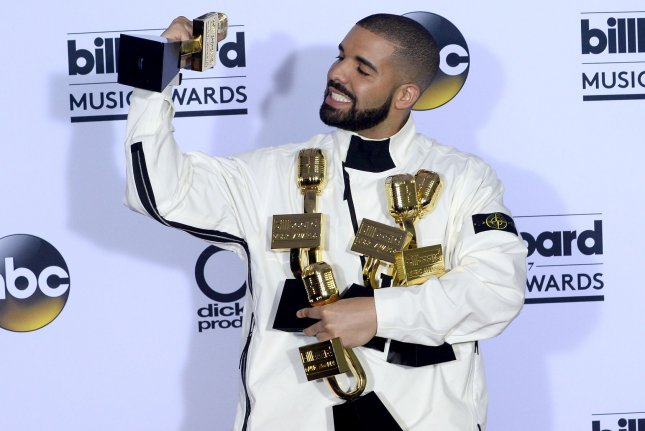 Drake appears backstage with his awards during the annual Billboard Music Awards held on May 21. File Photo by Jim Ruymen/UPI