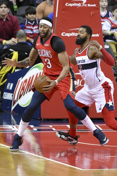 New Orleans Pelicans forward Anthony Davis moves toward the basket in a game against Markieff Morris and the Washington Wizards in December. Photo by Mark Goldman/UPI