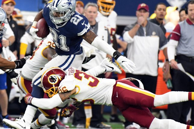 Dallas Cowboys running back Ezekiel Elliott gets taken down by Washington Redskins defender Su'a Cravens during the first half of their game in 2016 at AT&T Stadium in Arlington, Texas. Photo by Ian Halperin/UPI
