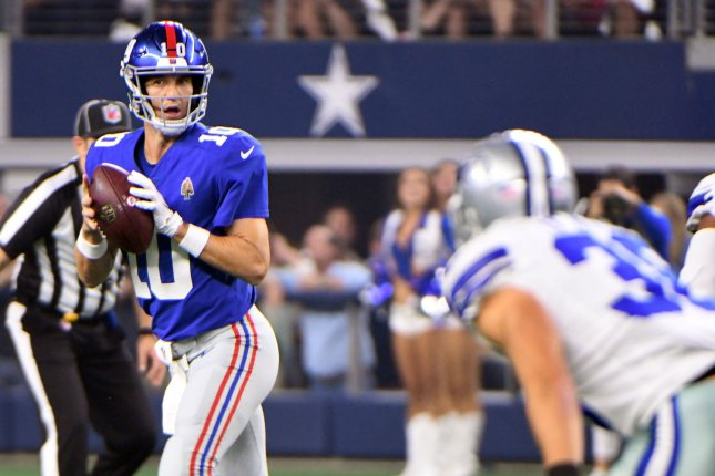 New York Giants quarterback Eli Manning (10) scrambles out of the pocket against the Dallas Cowboys during the first half on September 16, 2018 at AT&T Stadium in Arlington, Texas. Photo by Ian Halperin/UPI