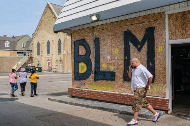 Downtown Kenosha has seen residents make art out of boarded up buildings amid protests August 31. On Friday, a 17-year-old accused of killing two Kenosha protesters was extradited to the county jail there. File Photo by Alex Wroblewski/UPI