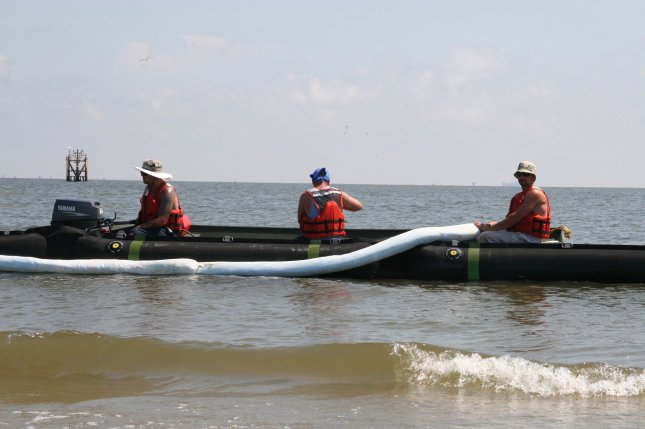 Absorbant boom is put in place May 20, 2010, to stop oil from the Deepwarter Horizon spill in the Gulf of Mexico. UPI/Stephen Lehmann/U.S. Coast Guard