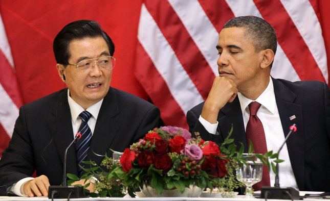 Chinese President Hu Jintao (L) speaks as U.S. President Barack Obama (R) listens as they meet with U.S. and Chinese business leaders and CEOs at the Eisenhower Executive Office Building January 19, 2011 in Washington, DC. UPI/Alex Wong/Pool