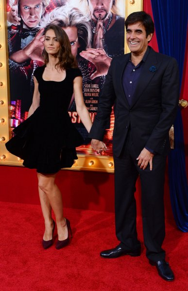 Magician David Copperfield and Chloe Gosselin attend the premiere of the motion comedy The Incredible Burt Wonderstone, at TCL Chinese Theatre in the Hollywood section of Los Angeles on March 11, 2013. UPI/Jim Ruymen