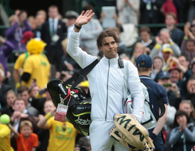 Spain's Rafael Nadal waves to the crowd after defeat to Richard Darcis on the first day of the 2013 Wimbledon Championships in London on Monday June 24 2013. UPI/Hugo Philpott