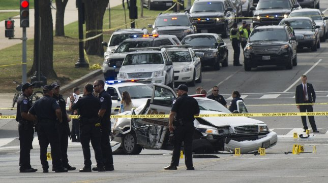 Capitol Hill Police respond to the crime scene after a vehicle chase ended in gun fire near the U.S. Capitol Building in Washington, D.C. on October 3, 2013. UPI/Kevin Dietsch