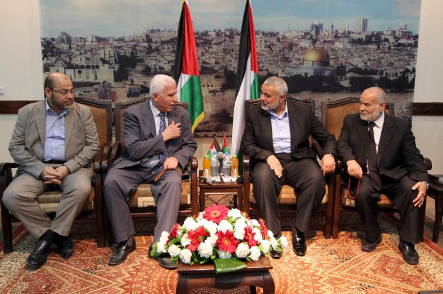 Hamas deputy leader Musa Abu Marzuk (L) a head of the delegation of the Palestine Liberation Organisation (PLO)and senior figure in the mainstream Fatah party of president Mahmud Abbas Azzam al-Ahmad (2L), Hamas prime minister in the Gaza Strip Ismail Haniya (2R), and deputy head of the Palestinian Parliament Ahmad Bahar (R) chat during a meeting with members of the PLO delegation and leaders of Palestinian factions at his home in Gaza City on April 22, 2014. The Palestinians have relaunched efforts to reconcile their rival leaderships in the West Bank and Gaza Strip as US-brokered peace talks with Israel teeter on the edge of collapse (UPI/Ahmad Shaath/Palestinian PM Media)