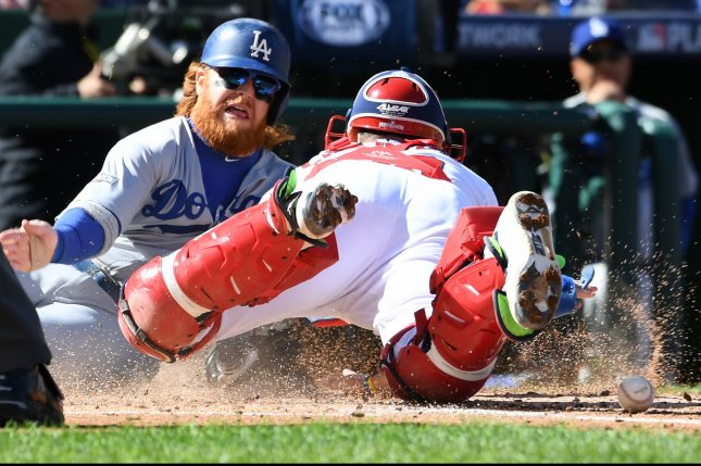 Washington Nationals catcher Jose Lobaton loses the ball as Los Angeles Dodgers third baseman Justin Turner scores in the third inning of game 2 of the National League Division Series at Nationals Park in Washington, D.C., October 9, 2016. Los Angeles leads the series 1-0 over Washington. Photo by Pat Benic/UPI