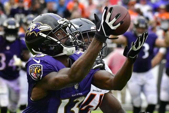 Baltimore Ravens wide receiver John Brown (13) catches a 44-yard pass for a first down in front of Denver Broncos cornerback Isaac Yiadom (41) during the first half of an NFL game on Sunday at M&T Bank Stadium in Baltimore. Photo by David Tulis/UPI