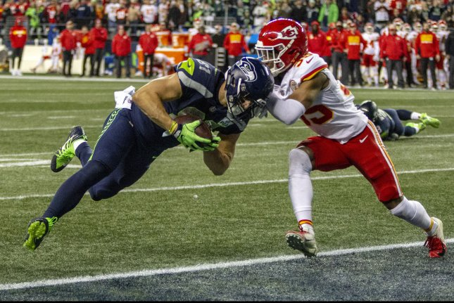 Seattle Seahawks tight end Nick Vannett (81) catches a one-yard touchdown pass Sunday against Kansas City Chiefs cornerback Charvarius Ward (35) at CenturyLink Field in Seattle, Washington. Photo by Jim Bryant/UPI