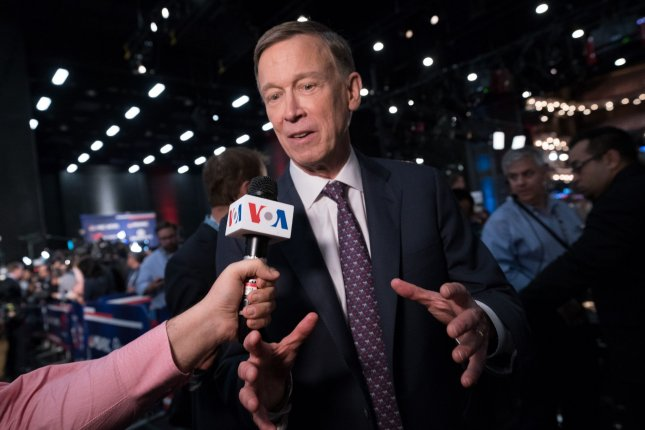 Democrat John Hickenlooper speaks to reporters June 27 after a primary debate in Miami, Fla. File Photo by Kevin Dietsch/UPI
