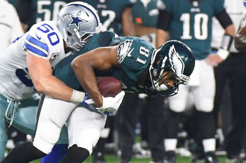 Dallas Cowboys Sean Lee wraps up the Philadelphia Eagles Jordan Matthews during the first half at AT&T Stadium in Arlington, Texas on October 30, 2016. Photo by Ian Halperin/UPI
