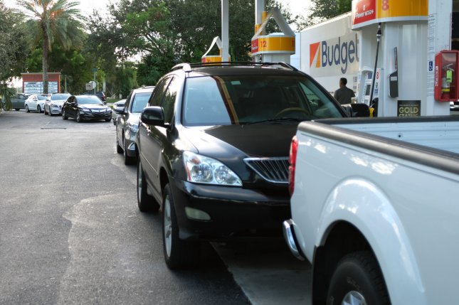 Gas prices in the United States are up about 25 cents per gallon from last year, which could start to eat away at discretionary spending. File photo by Gary I Rothstein/UPI