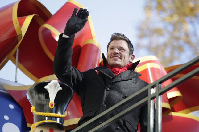 Nick Lachey of 98 Degrees ride the parade route at the 91st Macy's Thanksgiving Day Parade in New York City on November 23. Photo by John Angelillo/UPI