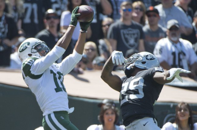 New York Jets receiver Jermaine Kearse (10) goes up for a 34-yard touchdown pass from quarterback Josh McCown as former Oakland Raiders cornerback David Amerson (29) tries to defend in the second quarter on September 17, 2017 at the Coliseum in Oakland, California. Photo by Terry Schmitt/UPI