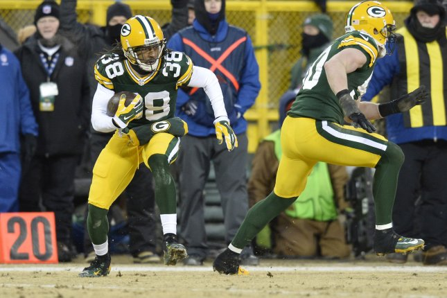 Green Bay Packers cornerback Tramon Williams (38) returns an interception 17 yards during the second quarter of the NFC Wildcard Playoff Game on January 5, 2014 against the San Francisco 49ers at Lambeau Field in Green Bay, Wisconsin. File photo by Brian Kersey/UPI