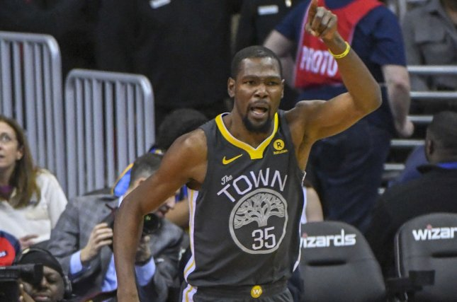 fce69a5d749 Golden State Warriors forward Kevin Durant (35) reacts after scoring in the  first half on February 28 at Capital One Arena in Washington