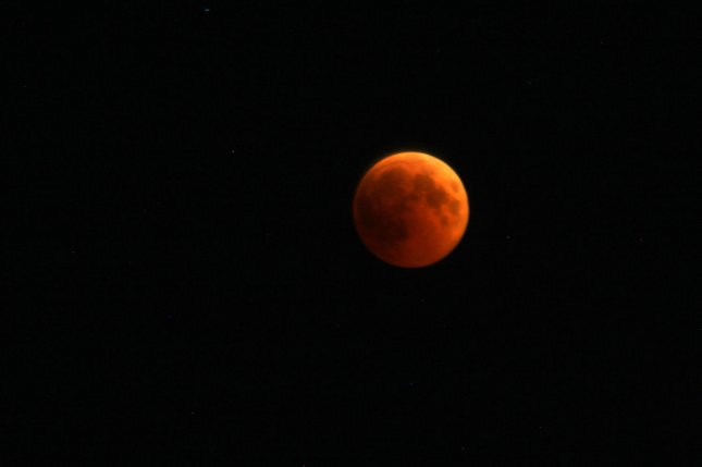 The red color of the moon during a lunar eclipse comes from the sun's ray's filtering through Earth's atmosphere. File Photo by Ismael Mohamad/UPI