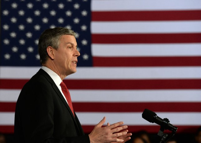 U.S. Education Secretary Arne Duncan makes a few comments before President Barack Obama unveils a speedup to his ConnectED initiative at Buck Lodge Middle School in Adelphi, Maryland on February 4, 2014. UPI/Pat Benic