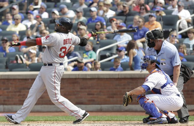 Boston Red Sox slugger David Ortiz hits a 2-run home run in the 6th inning against the New York Mets at Citi Field in New York City on August 30, 2015. He confirmed he will retire after the 2016 season. Photo by John Angelillo/UPI
